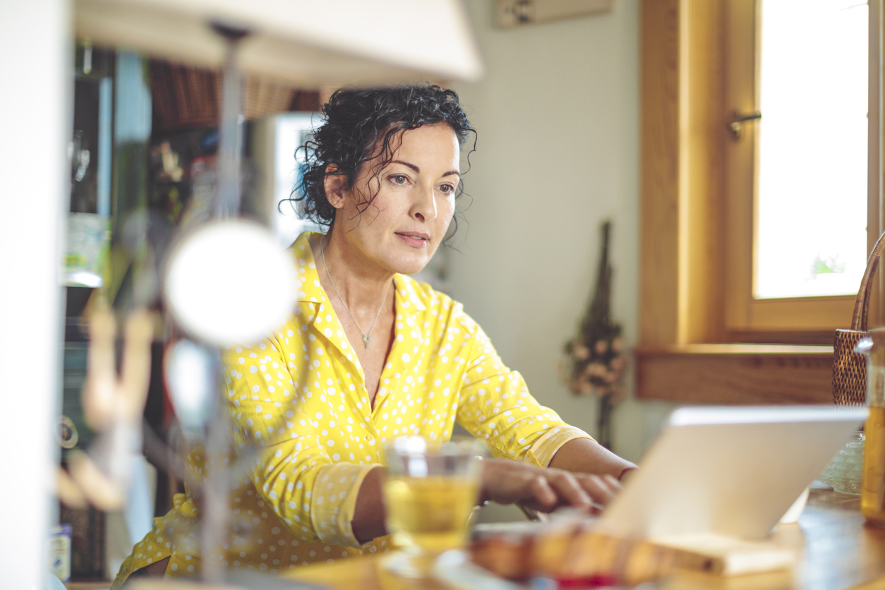 mature-woman-is-checking-her-finances-at-home